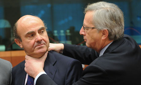 Jean-Claude Juncker, right, playfully strangles minister Luis de Guindo, left. Or maybe he's just really strangling him for Spain's fiscal irresponsibility?